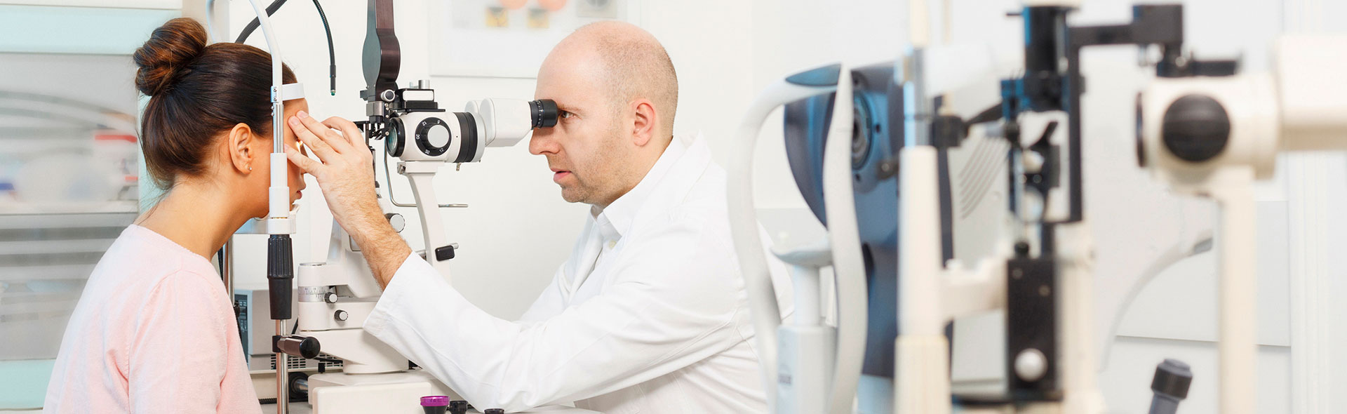 Eye Doctor performing an Eye Exam