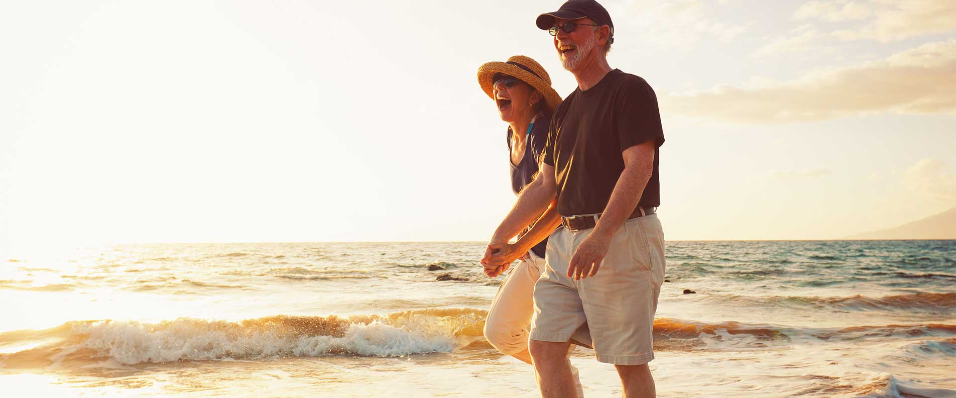 Couple walking on the beach after Cataracts