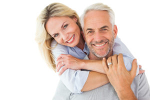 Middle Aged Couple Seeing Clearly after Glaucoma Surgery