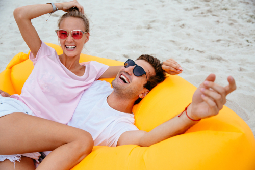 Young couple enjoying the beach after LASIK